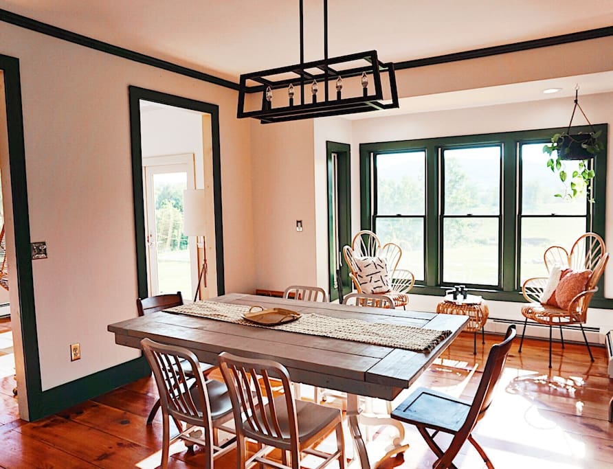 The dining room + sitting area- Gorgeous Sunsets! Featuring our custom built table