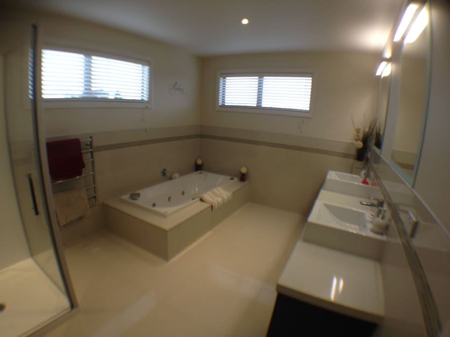 Large bathroom with twin hand basins and shower