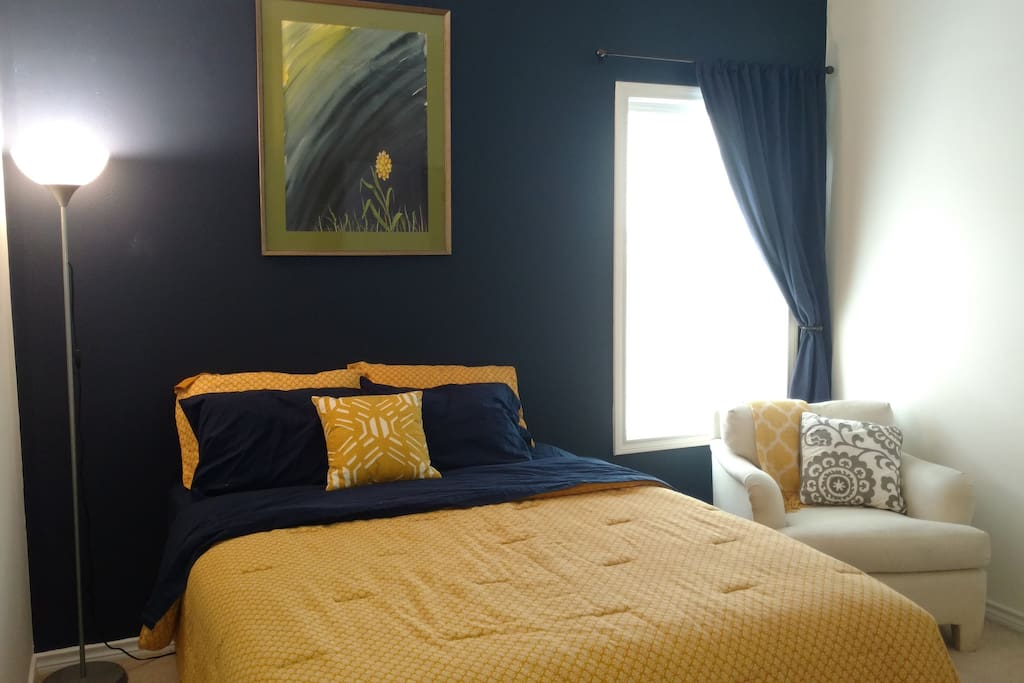 A comfortable queen bed and a black out curtain for your best night's sleep away from home.