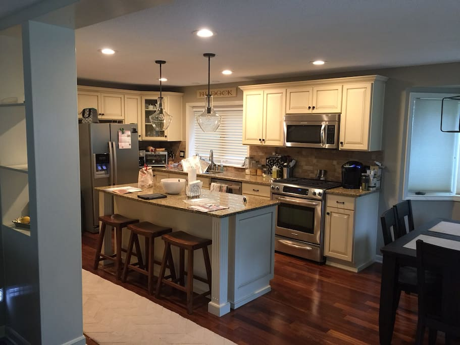 Gourmet kitchen complete with large eat-in island and gas range.