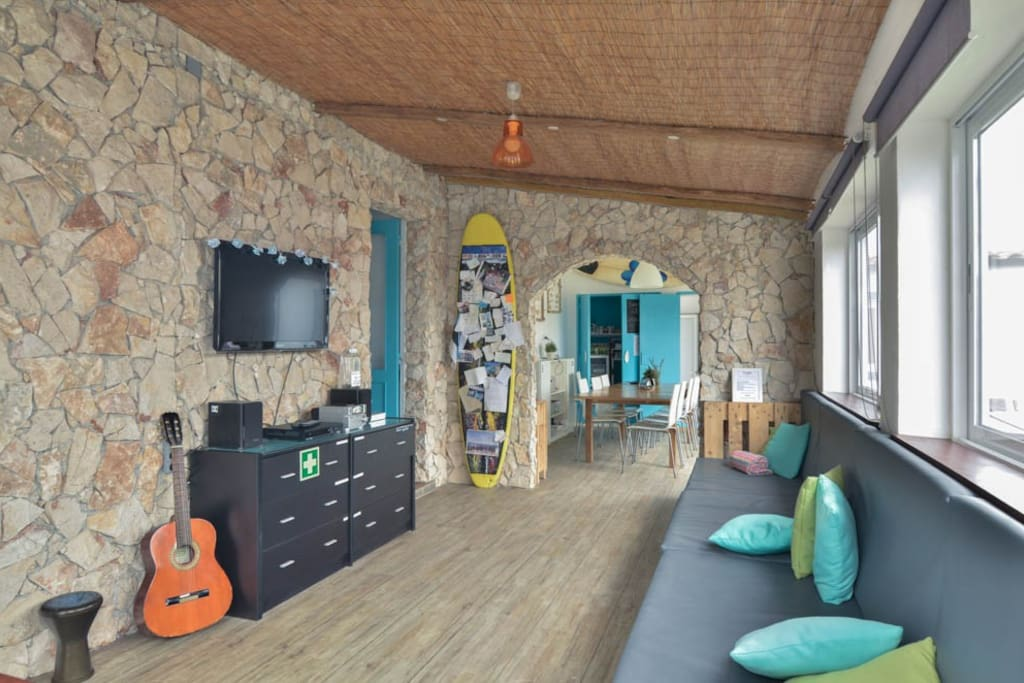 Our cozy lounge is equiped with comfy coutch, TV, radio, sound system, books, magazines and of course--guitare :-)