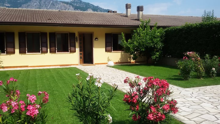 Holiday Apartment Garden Maisonette directly by Lake Garda with Mountain View, Wi-Fi & Balcony; Parking Available