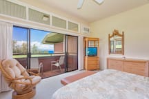 Unwind after a long day in your beautiful master bedroom with golf and ocean views