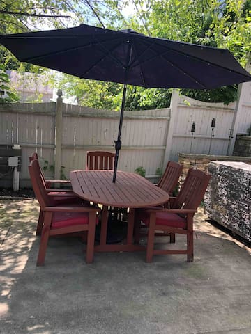 Outdoor seating that is apart of the shared backyard