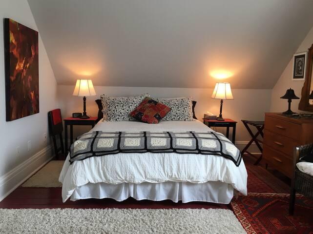 West bedroom with queen bed.
