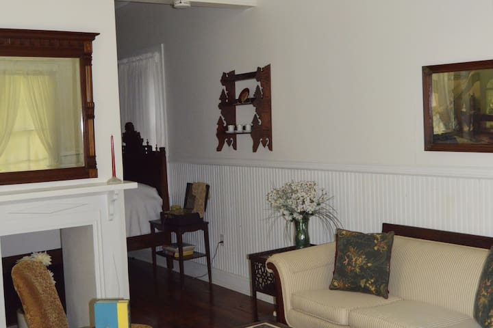 Living Room furnished with beautiful antiques
