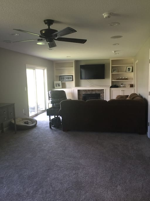 Large downstairs living room with full entertainment center