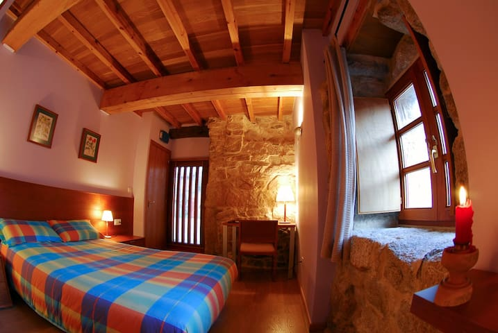 Double room with wooden beams.