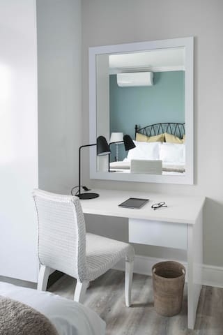 An elegant laptop work-space with a corian counter-top.