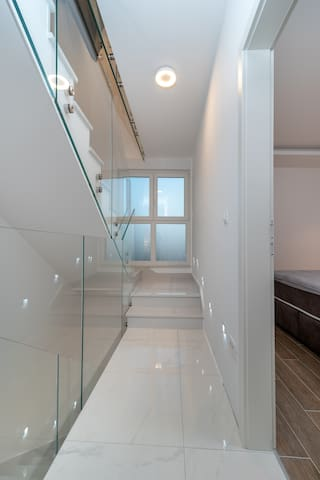 Hallway with glass railing on the 1st floor