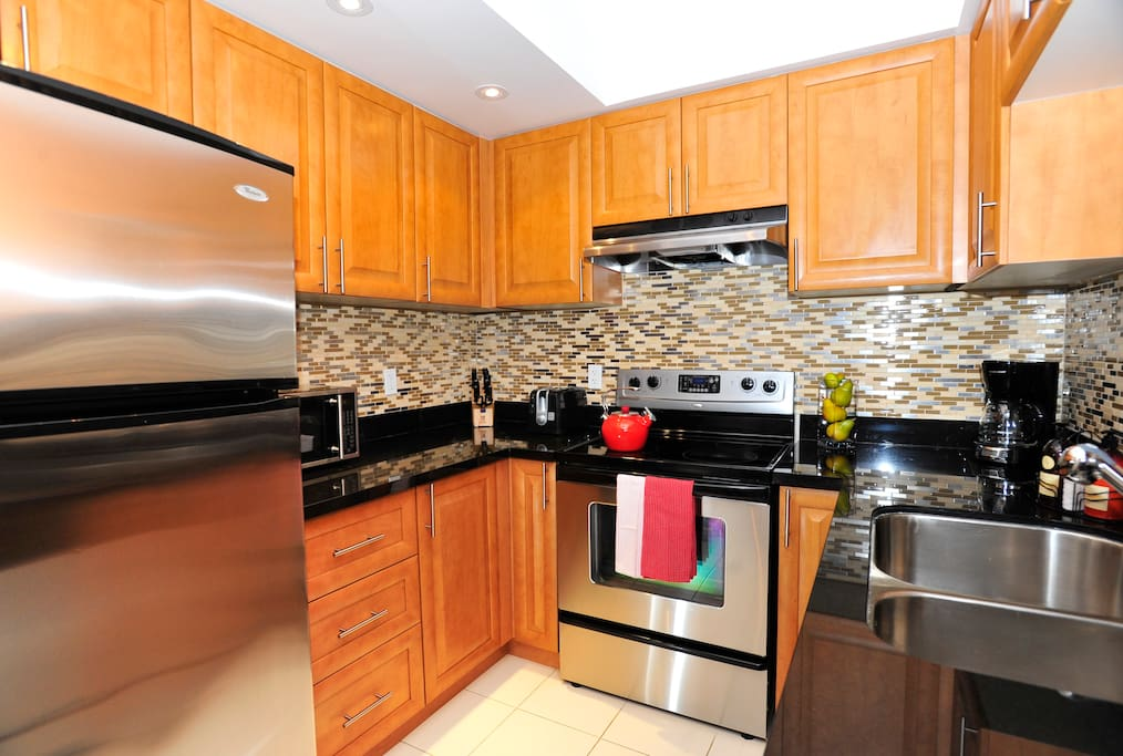 Fully equipped kitchen with 4 full sized stainless steel appliances.