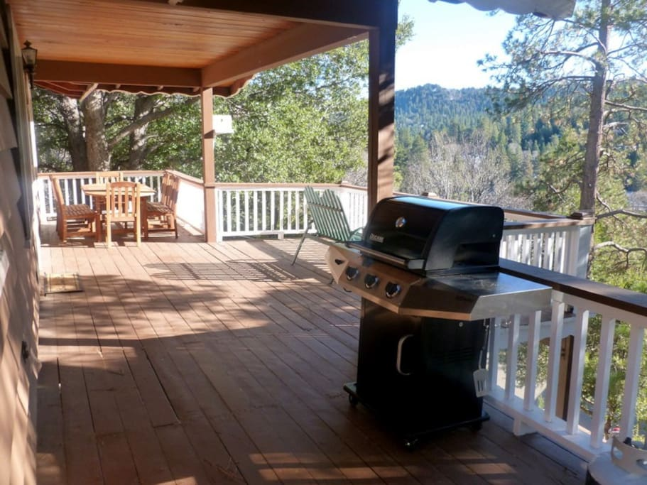 The deck is equipped with an outdoor teak dining table that comfortably seats 8 adults and a propane grill/tanks for all your entertaining needs!