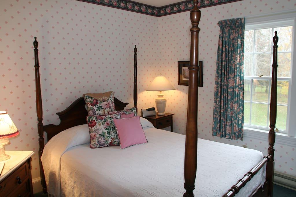 Queen room with 4 post bed overlooking side gardens.