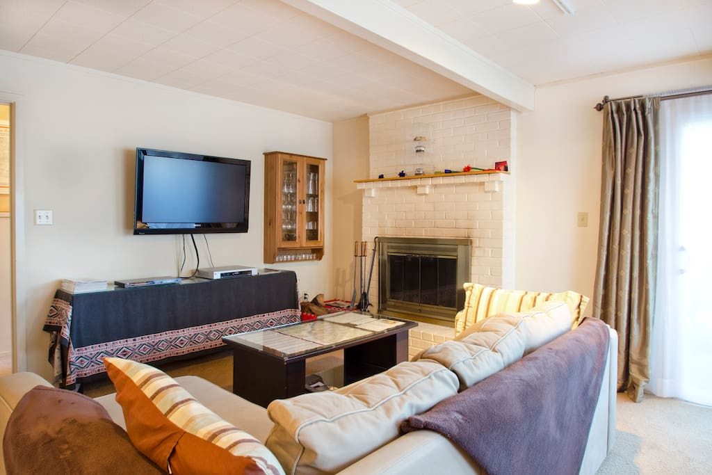 This view of the living room shows the entertainment center as well as the fireplace.
