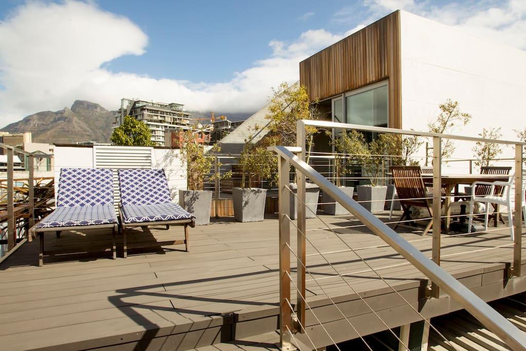 Sunloungers on rooftop terrace