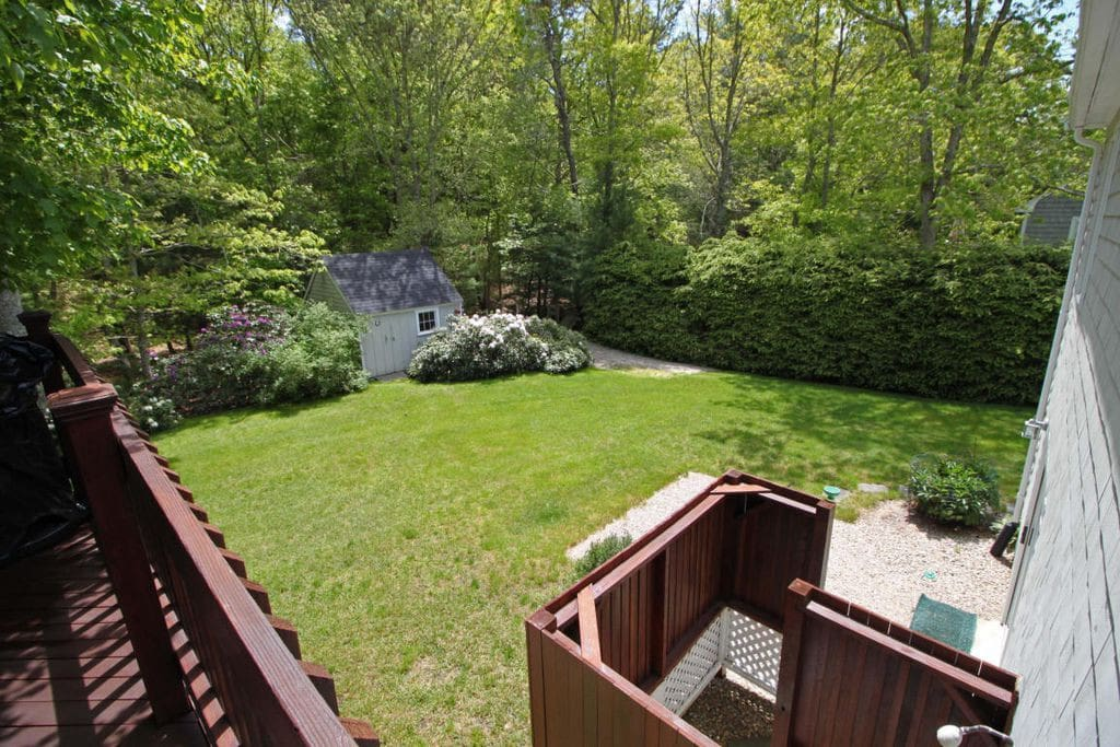 Gorgeous landscaped backyard complete with a fire pit