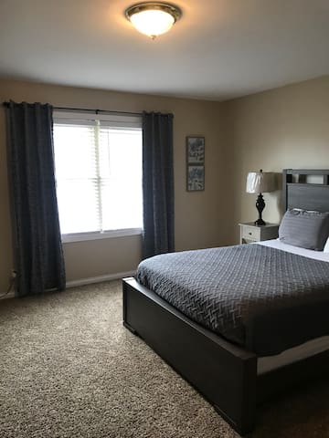 Updated Master bedroom with a 55inch smart tv! Brand new bedding, blinds, curtain & light fixtures.