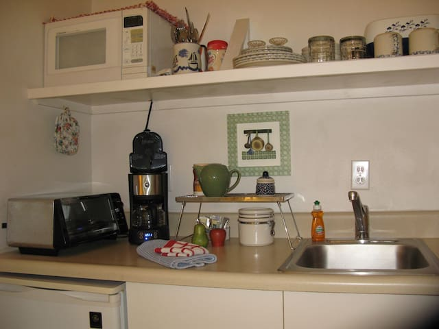 Fully equipped kitchenette: fridge, sink, toaster oven, microwave, crock pot, electric fry pan, coffee maker, dishes, pans, utensils, etc.