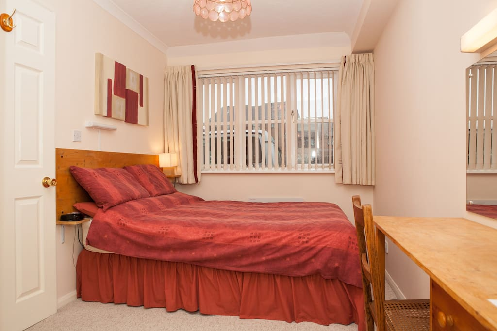 Ground floor double guest bedroom with modern en-suite wc, washbasin and shower