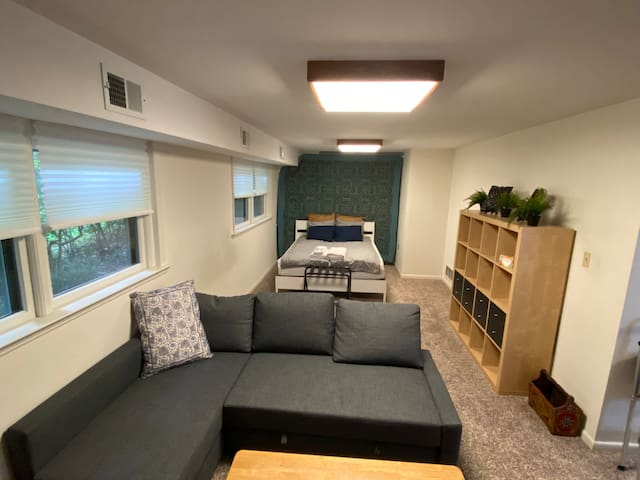 Spacious 25' x 11' bedroom/living room is half of your suite!  PLENTY of space to organize your things for a longer stay.