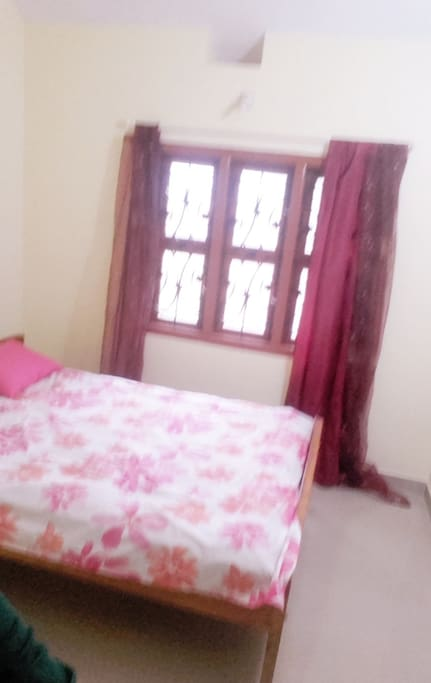 Spacious Bedroom where you awaken to the sweet sound of birds chirping.