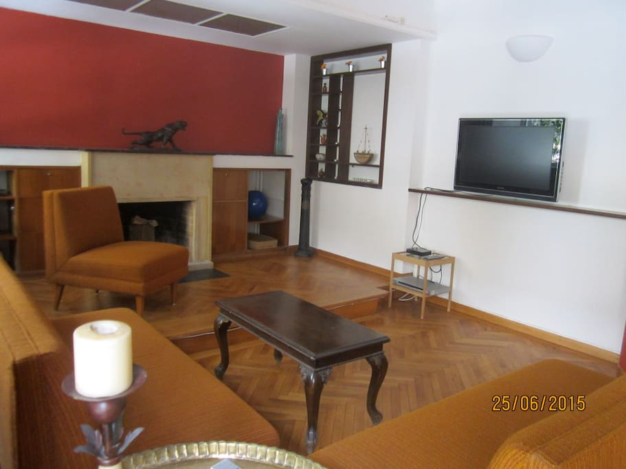 Large sitting room with TV set, DVD set, fire place and long beautiful balcony.