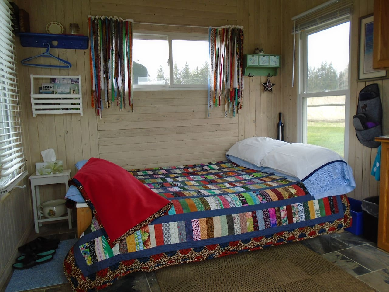 This super comfy bed is covered in hand made bedding from the quilts to the pillow cases to the cozy throw.