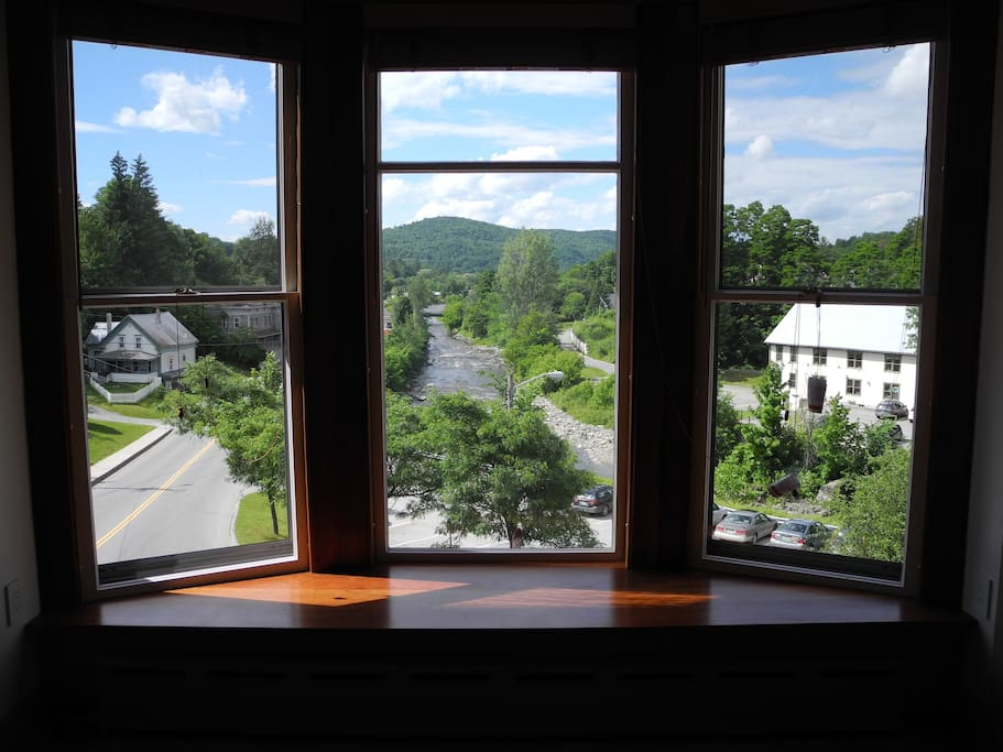 View out the apartment bay window of the Lamoille River and the Green Mountains beyond.