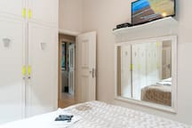 2nd bedroom facing tv and mirror