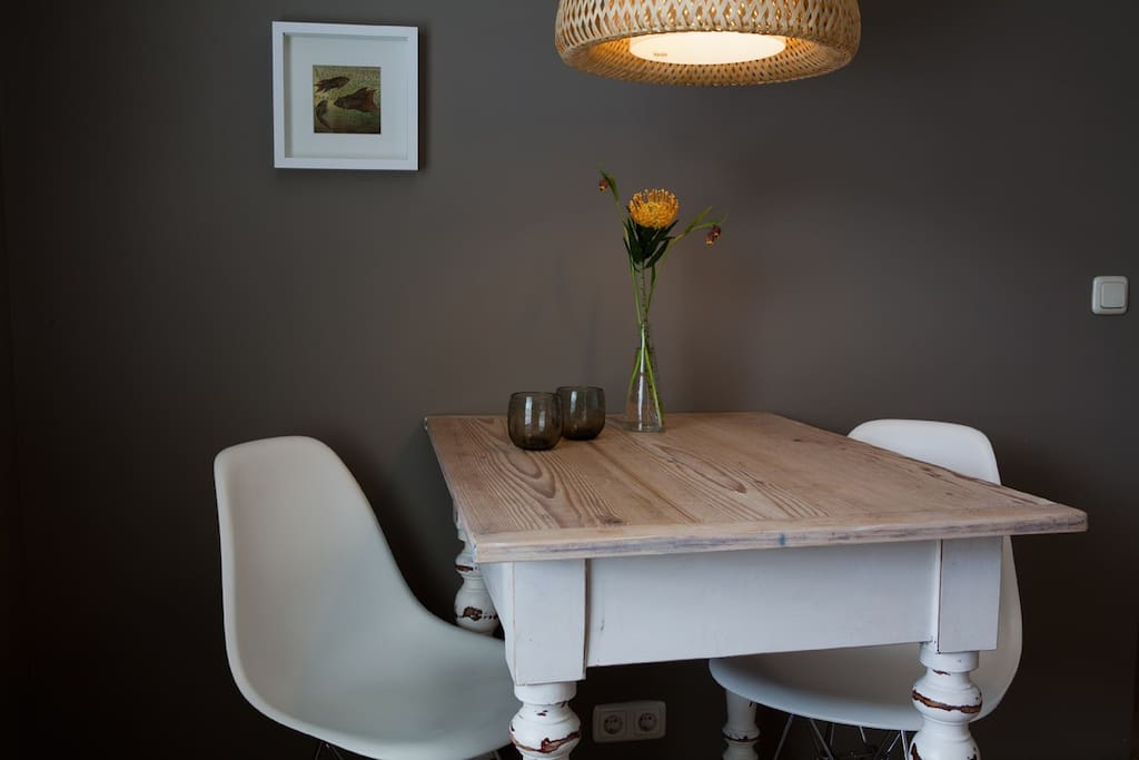Kitchen table with Charles Eames chairs.
