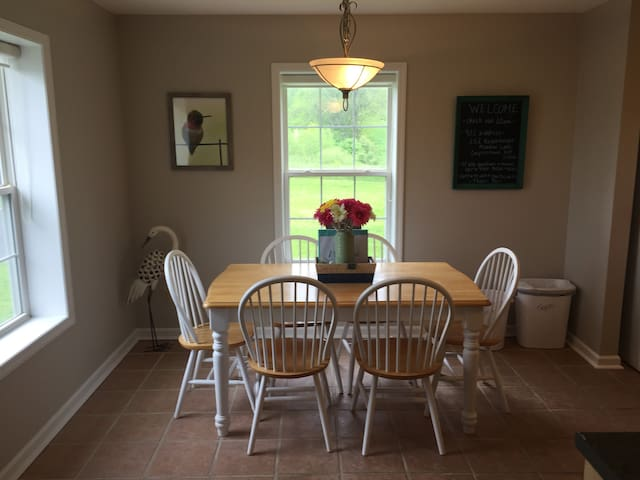 Dining table in spacious kitchen.