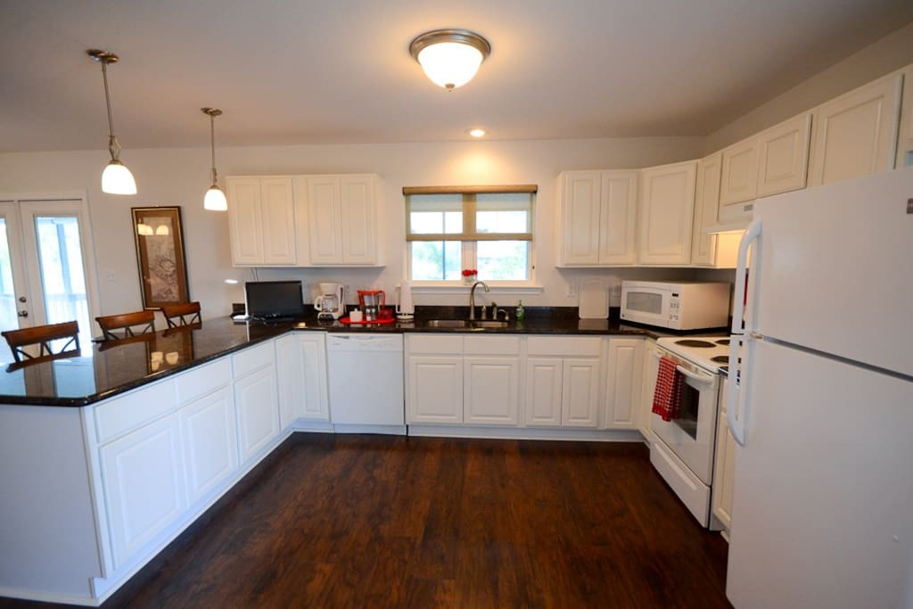 Full kitchen with dishwasher and microwave