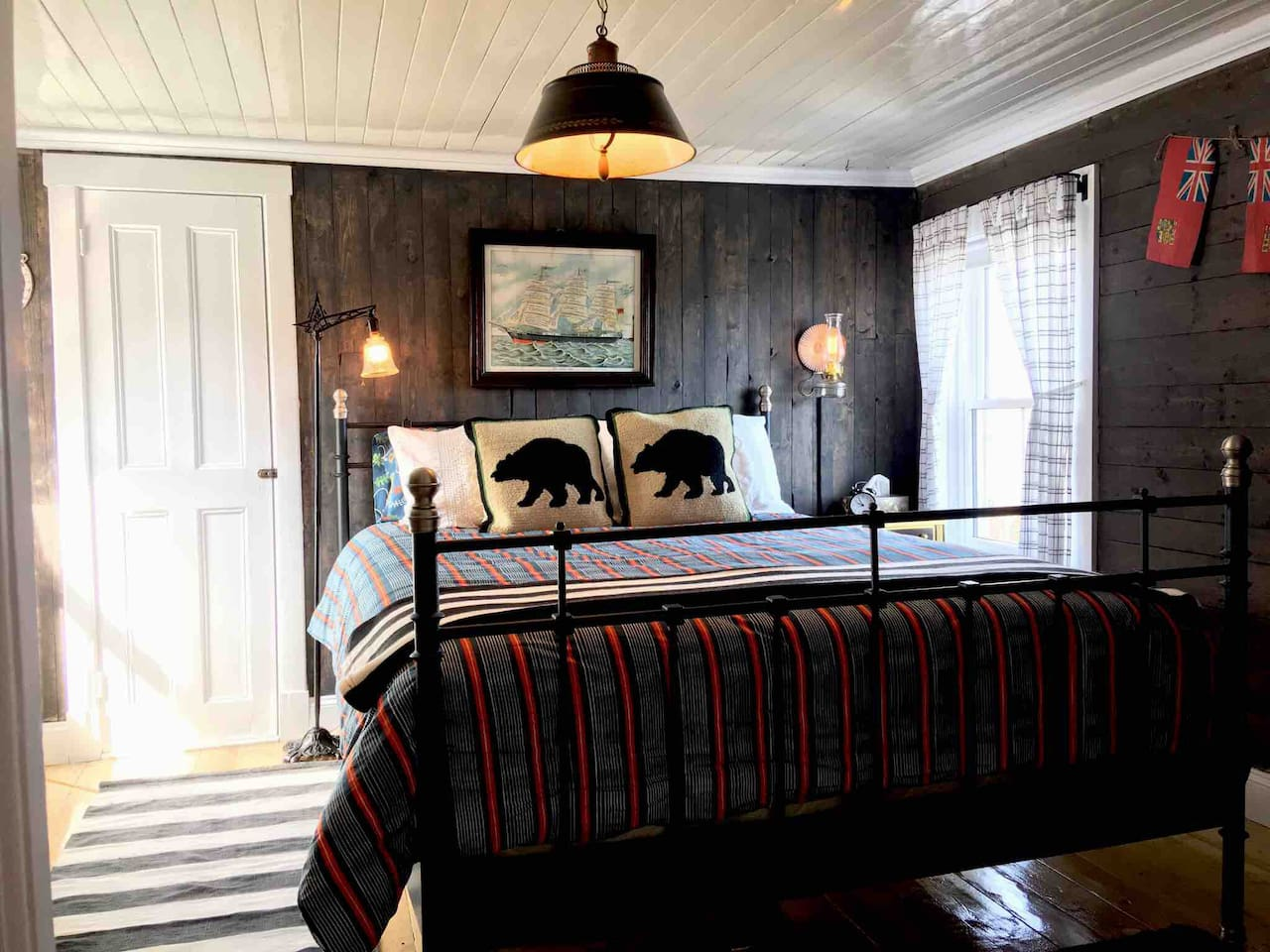 The Captain's Suite, the master bedroom with a queen sized bed, ensuite powder room and a view of the bay