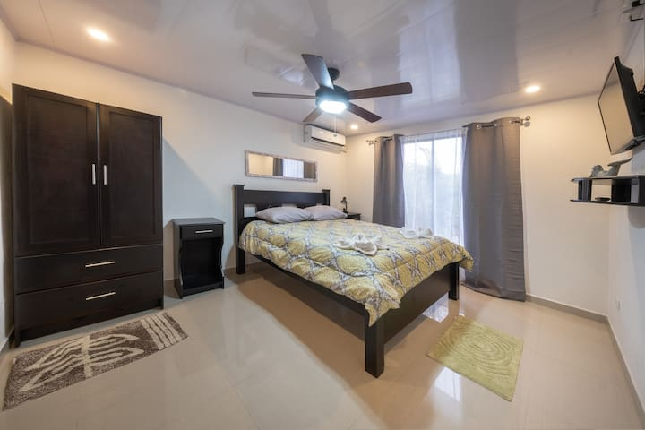 Master Suite #2 with AC, Private Bathroom and TV.