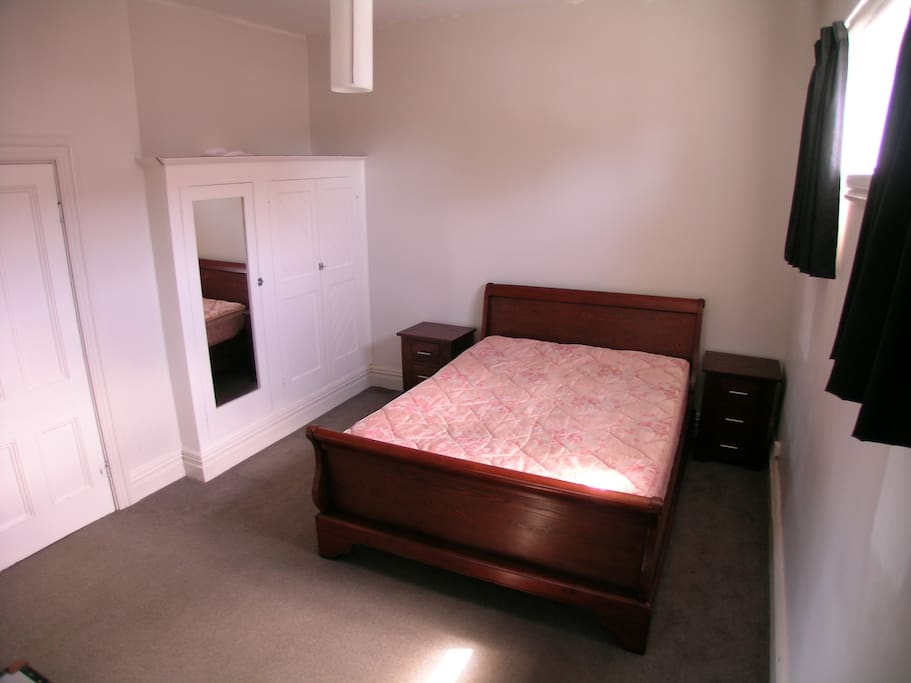 Large Double Bedroom with generous wardrobe.