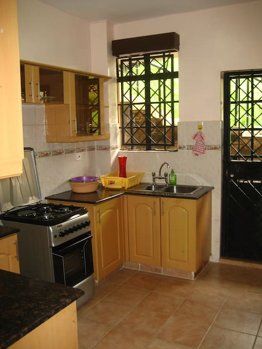 Nice, bright kitchen with access to the balcony, there for you to cook some nice meals.
