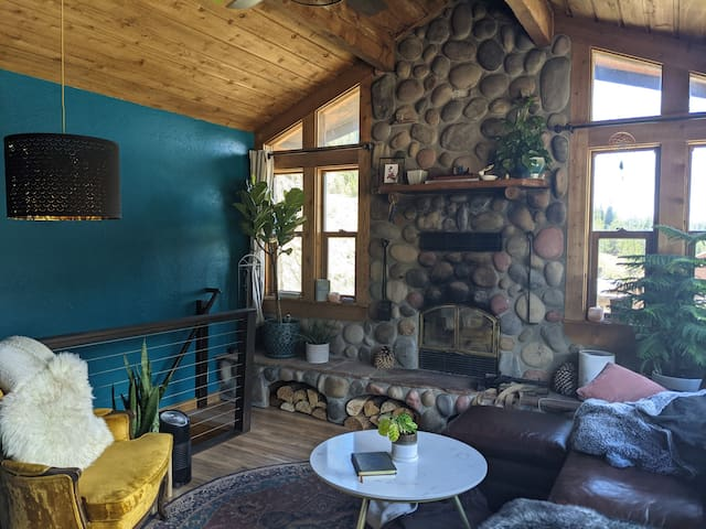 Cozy living room tastefully decorated with views of fourteeners from the couch.