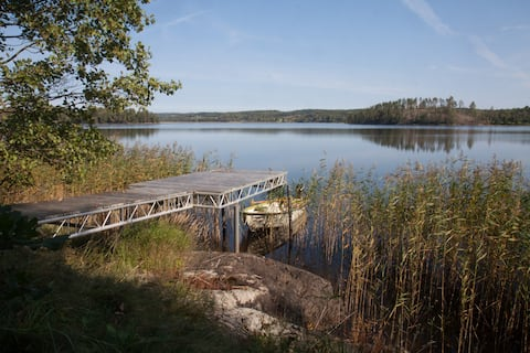 Lie back an relax in our peaceful lakeside cottage