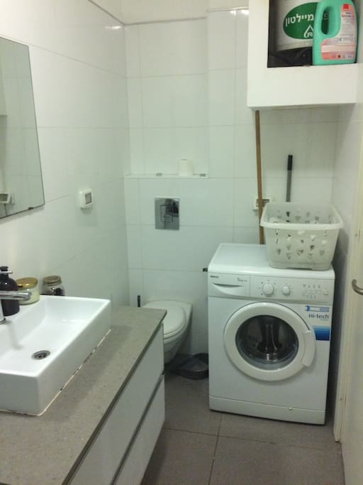 Large basin sink, loads of counter space, and a washer for the guests to use.