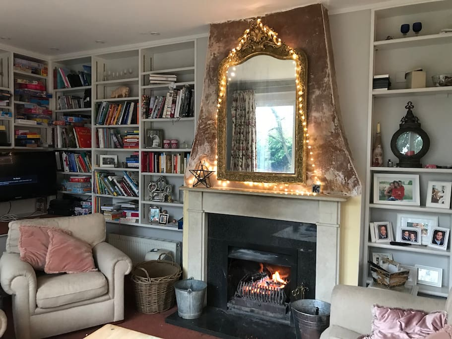 Sitting room with open log fire. Perfect place to snuggle up talk and play games