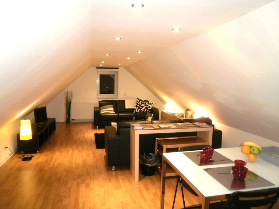Wohnzimmer mit Essbereich Lounge with dining area