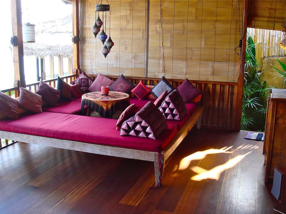 Comfofortable outside sitting area with plenty of space for yoga. This sitting space can also double up as an outside kids bedroom