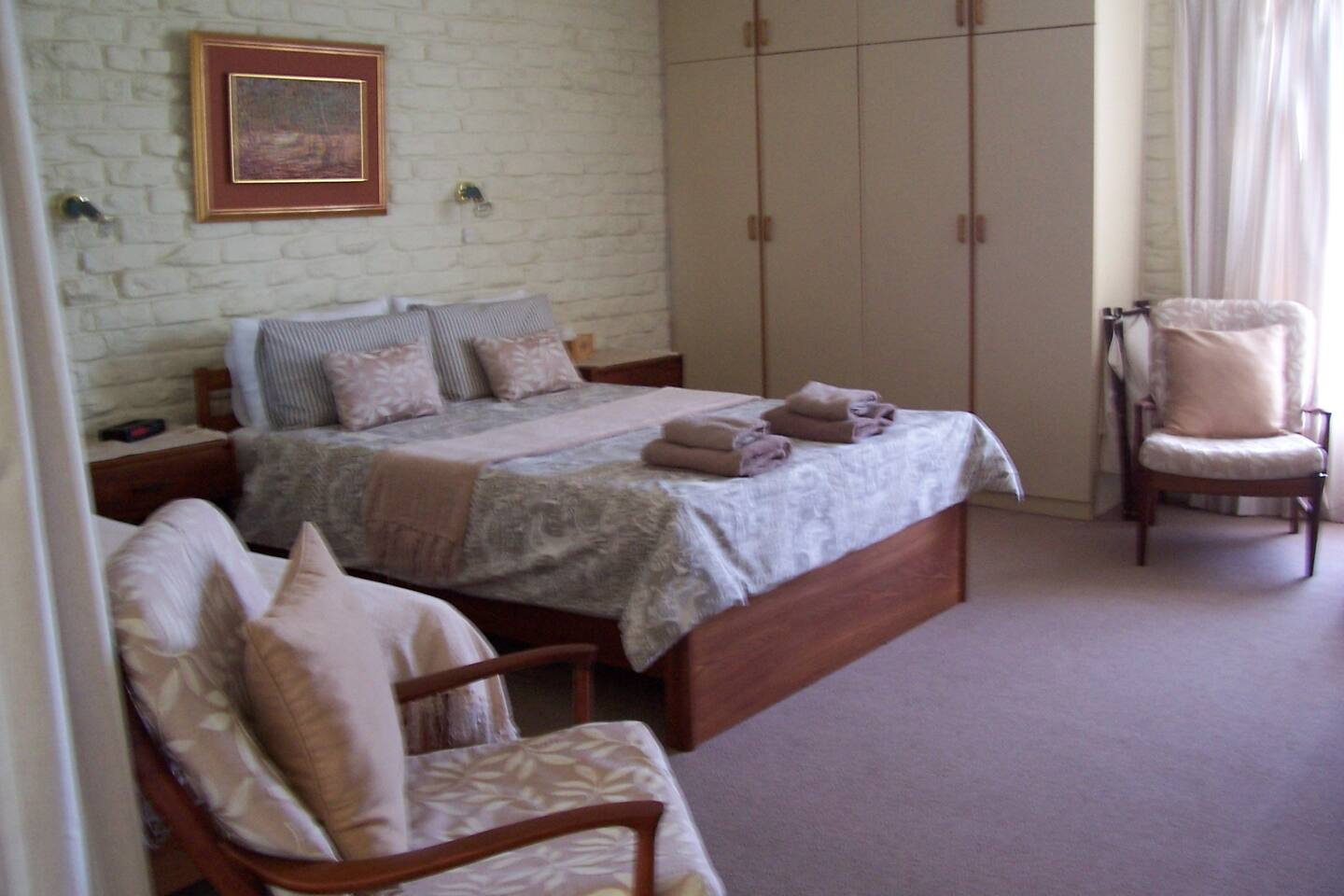 Bedroom with double bed and a single bed