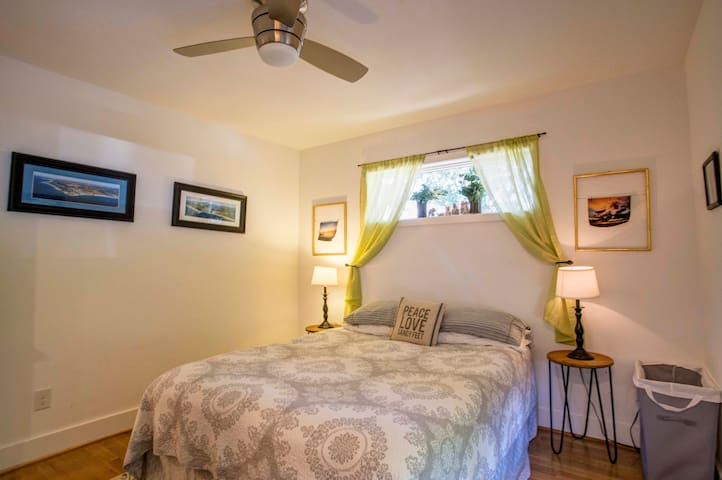 The bedroom is off the kitchen with a Queen size bed. Bed has a removable pillow top mattress pad so you can choose - firm or soft - and have your best sleep away from home!