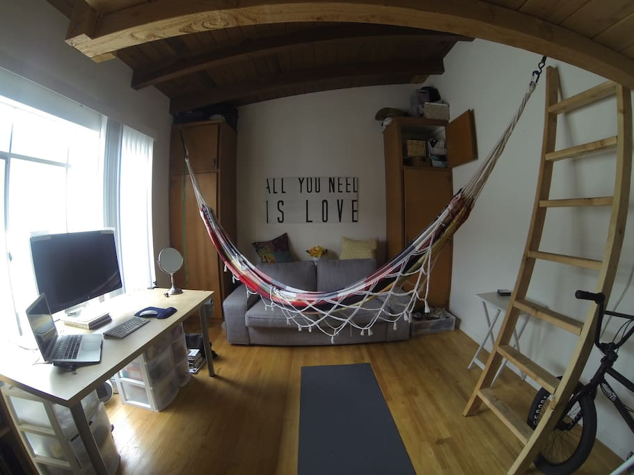 Hammock life. Attach/detach to two securely fashioned i-bolts hanging from trusses
