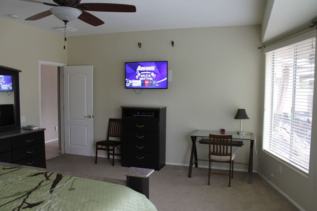 "Master bedroom with 41"" Smart TV"