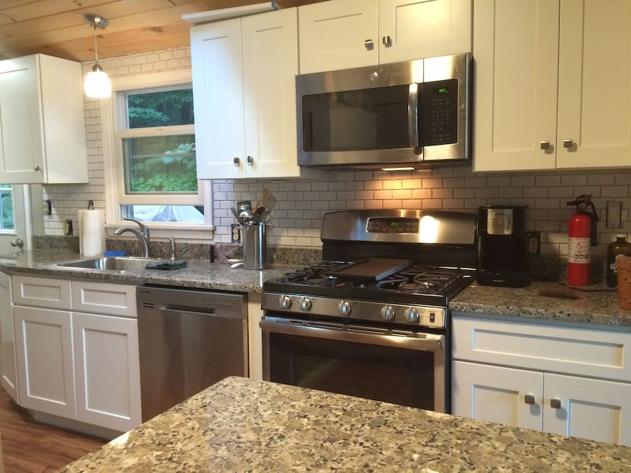 Brand new kitchen with granite countertops and all gas appliances