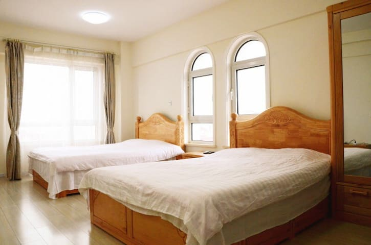 Golden Holiday Apartment - Dalian - Lakás