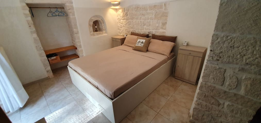 New, very confortable kingsize beds in all rooms. Trulli-Room 2 for 3 People with 2Beds, own Entrance, Bathroom, Sonos Speakers with Spotify, Smart-TV with Netflix and international TV-Channels and Minibar.