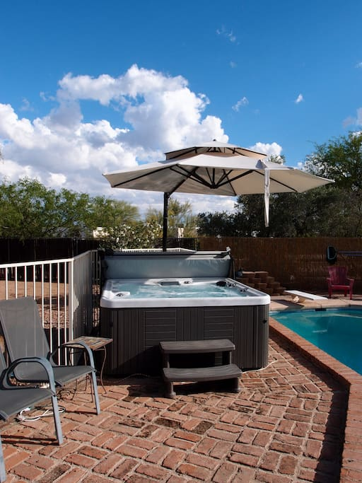 Hot tub with cantilever umbrella out.